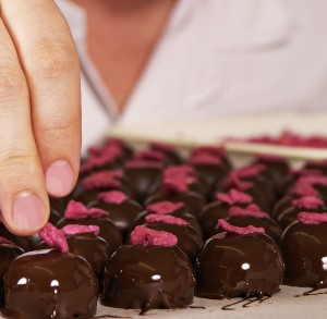 Hand making chocolate truffles